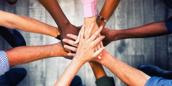 Selection of people with their hands together