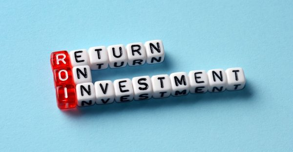 ROI Return On Investment written on dices on blue background